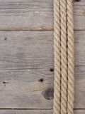 Rope on dark wood Stock Image