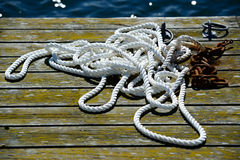 Rope on deck. White rope on a deck by the sea royalty free stock photos