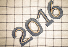 Rope and denim digits 2016 on a checkered cloth background. Tone Royalty Free Stock Photo