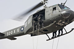 Rope-descending from helicopter Royalty Free Stock Photos