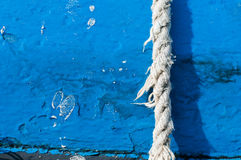 Rope. Dilapidated rope on blue background Stock Photos