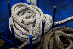 Rope. Dirty rope on a blue background Royalty Free Stock Image