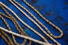 Rope. Dirty rope  on a blue background Stock Photo
