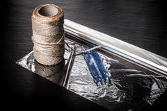 Rope e ajuste para a carne da repreensão em um fundo preto toned Foto de Stock Royalty Free