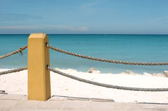 Rope Fence At Beach. Colorful rope fence on Aruba beach Stock Photo