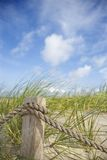 Rope fence on beach. Royalty Free Stock Photo