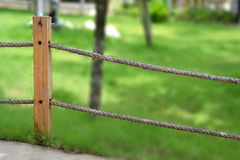 Rope fence in garden Stock Image