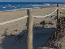 Rope fence on the sandy beach of La Mata. Sunset on the beach. Blurred unfocused blue sea background 04 Stock Photography