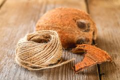 Rope of fiber coir and coconut shell on an old wooden table. Rope of fiber coir and coconut shell on an old wooden table Stock Photo