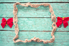 Rope frame with bows Royalty Free Stock Photo