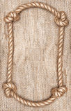 Rope frame and burlap background Royalty Free Stock Image