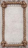 Rope frame, linen fabric and wood background Stock Photo