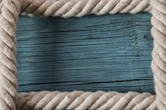 Rope frame on old wood texture Stock Images