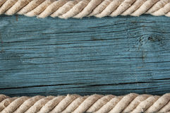 Rope frame on old wood texture Royalty Free Stock Images