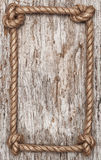 Rope frame and wood background Stock Photo