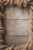 Rope frame on wooden background Stock Photo