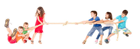 Rope game. Little kids playing the rope game isolated in white Royalty Free Stock Photography