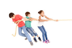 Rope game. Little kids playing pulling rope isolated in white Royalty Free Stock Photography