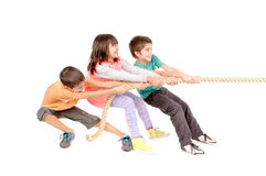 Rope game. Little kids playing pulling rope isolated in white Stock Photography