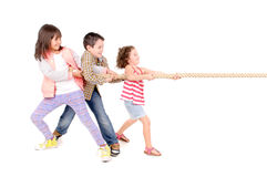 Rope game. Little kids playing pulling rope isolated in white Royalty Free Stock Photos