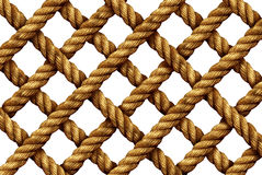 Rope Grid Pattern. As a group of strong thick nautical cords connected in a geometric shape as a marine net isolated on a white background Royalty Free Stock Photos