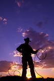 Rope ground. A cowboy silhouetted in the sunset with a rope Royalty Free Stock Photography