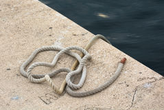 Rope on the Ground in the Harbor Royalty Free Stock Photos