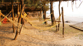 Rope hammocks in a beach in India. Rope hammocks tied in one of the beaches in Western India , during evening time Royalty Free Stock Images