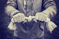 Rope in hands of man. concept of violence and human rights. Royalty Free Stock Photo