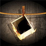 Rope hanging and burning old photo. Vector background with a rope hanging and burning old photo Royalty Free Stock Photography