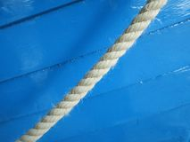 Rope hanging near a blue painted lifeboat in the harbor of Den Helder Netherlands. A rope hanging near a blue painted lifeboat in the harbor of Den Helder stock photos