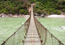 Rope hanging suspension bridge Royalty Free Stock Image