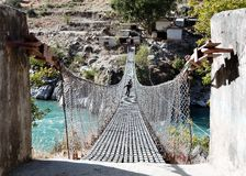 Rope hanging suspension bridge in Nepal Royalty Free Stock Photography