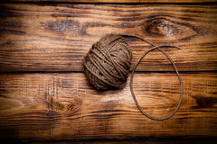 Rope hank on old wooden burned table or board for background. To Stock Image