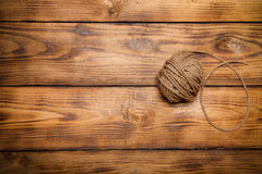 Rope hank on old wooden burned table or board for background. To Royalty Free Stock Photos