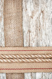 Rope, hardware and sacking ribbon on the old wood Royalty Free Stock Photo