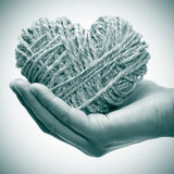 Rope heart. Someone holding a heart-shaped coil of rope in his hand as a present Stock Photography