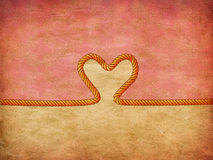 Rope heart on decorative paper Royalty Free Stock Photo