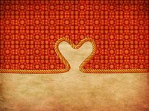 Rope heart on decorative paper Royalty Free Stock Image