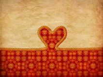Rope heart on decorative paper Stock Image