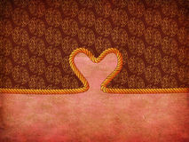 Rope heart on decorative paper Royalty Free Stock Photography