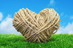 Rope heart on the grass Stock Photo