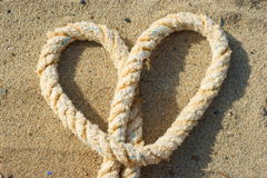 Rope with a heart knot Stock Photography