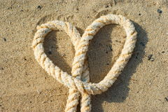 Rope with a heart knot Royalty Free Stock Images