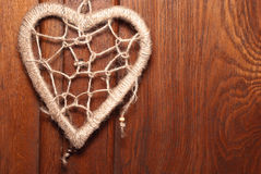 Rope heart on wood background Stock Images