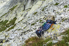 Rope, helmet, carabiners, climbing harness and descender on the rock Royalty Free Stock Photos