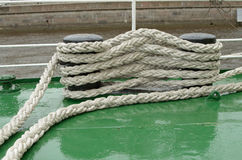 The rope holding the ship to the pier. Royalty Free Stock Image
