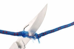 Rope and knife blade  Royalty Free Stock Images