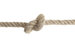 Rope with Knot. Natural rope with knot isolated on white background Royalty Free Stock Photo