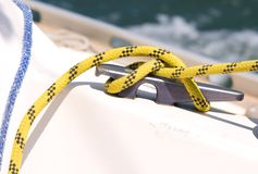 Rope knot. Detail of a knot of a rope in a deck of a sailboat royalty free stock photos